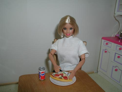 Barbie in the Kitchen Eating Pizza