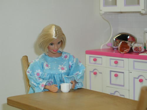 Barbie in the Kitchen Drinking Coffee